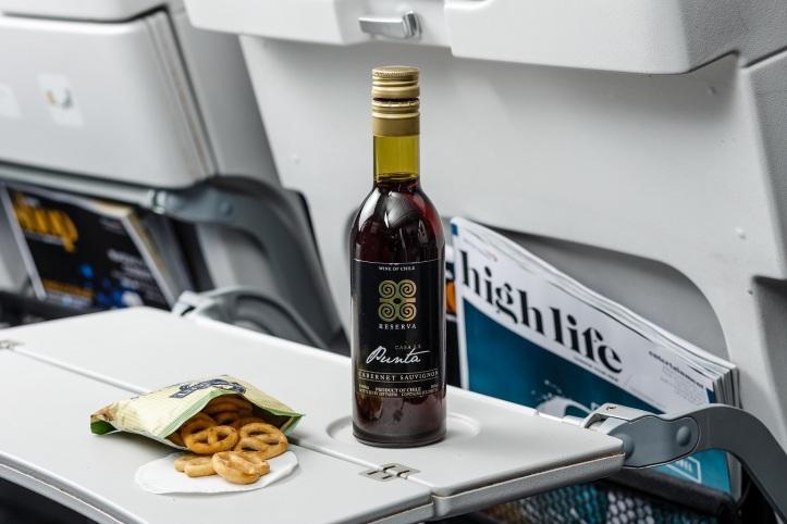 British Airways' new World Traveller catering - pretzels with red wine