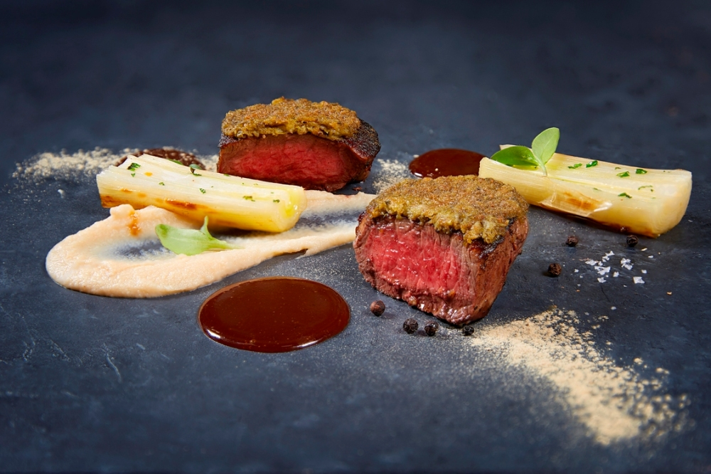 Black Angus beef tenderloin gratinated with liquorice and capers celery root puree leeks_credits solostepstudio