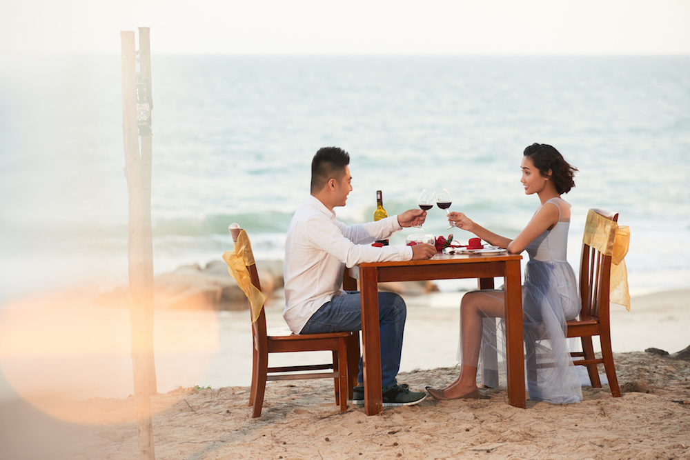 Loving Couple Toasting with Red Wine