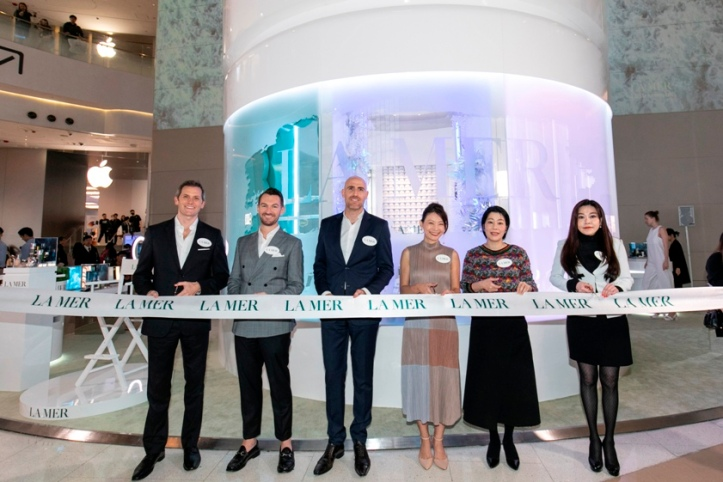 DFS, La Mer and Hysan Development brand representatives performing a ribbon cutting ceremony.jpg